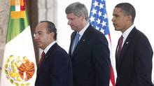 Prime Minister Stephen Harper, centre, Mexican President Felipe Calderon, left, and U.S. President Barack Obama make their way to a joint news conference at the conclusion of the North American Leaders Summit in Guadalajara, Mexico, on Aug. 10, 2009. (Adrian Wyld/The Canadian Press/Adrian Wyld/The Canadian Press)