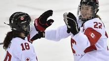 Canada's Catherine Ward, left, and Hayley Wickenheiser celebrate a goal against Switzerland (Nathan Denette/The Canadian Press)
