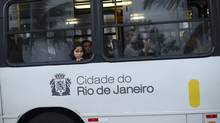 Commuters look out of a bus window as they are sit in rush hour traffic along the promenade beside the iconic Ipanema beach in Rio de Janeiro June 9, 2014. (Reuters)