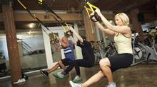 Participants try out a TRX fitness class at Get Spun in Toronto. (JENNIFER ROBERTS for The Globe and Mail)