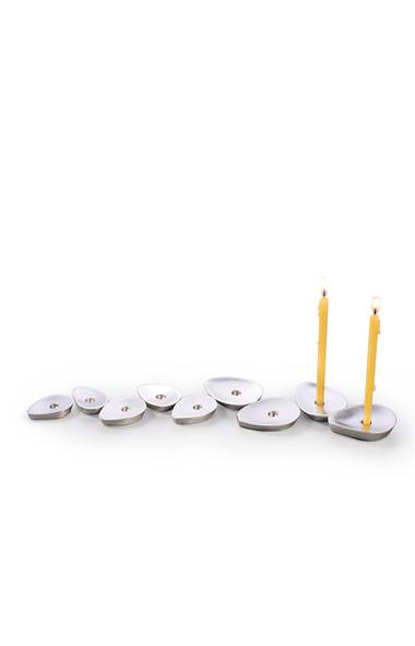 Made of matte aluminum, artist Anat Basanta's playfully symbolic menorah evokes prickly-pear leaves that 'grow' each night of the holiday. $150 through www.contemporaryjudaicadesigns.com . (Handout)