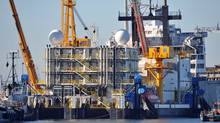 The Arctic Challenger alongside in Bellingham, Wash. Shell said Monday that a spill-containment dome being tested off the coast of Bellingham was damaged Saturday night in its final test. (Phillip A. Dwyer/Associated Press)