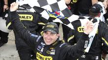 Marcos Ambrose celebrates his win at the NAPA Auto Parts 200 Nationwide Series NASCAR race in Montreal, August 20, 2011. (CHRISTINNE MUSCHI/REUTERS/Christinne Muschi)