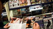 A customer checks out boxing magazines at the Chapters/ Indigo Eaton centre store in Toronto. (Sami Siva/Sami Siva/THE GLOBE AND MAIL)