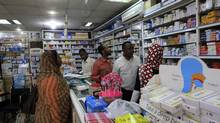 A customer buys medication at a pharmacy in Khartoum Jan. 13, 2013. Depreciation of the Sudanese pound has pushed inflation above 44 per cent and is making it harder and more costly for Sudanese to access drugs. (MOHAMED NURELDIN ABDALLAH/REUTERS)