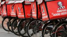 Logos of KFC, owned by Yum Brands Inc, are seen on delivery bicycles in front of its restaurant in Beijing. (Kim Kyung-Hoon/Reuters)