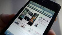 A web page is displayed on an Apple iPhone. (Graeme Roy/THE CANADIAN PRESS)