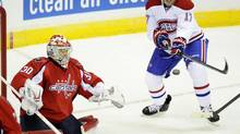 Montreal Canadiens left wing Rene Bourque (17) swats at the puck against Washington Capitals goalie Michal Neuvirth (30), of the Czech Republic, during the second period of an NHL game on Thursday, Jan. 24, 2013, in Washington. (Nick Wass/AP)