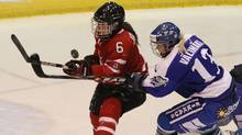Canadian defenceman Rebecca Johnston (#6) and Finland forward Linda Valimaki (#13) scramble for the puck during first period of Four Nations women's hockey action in St. John's on Friday Nov. 12, 2010. (Paul Daly)