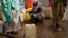 A woman waits in a queue to collect water at the Yusuf Batil refugee camp in Upper Nile, South Sudan, July 4, 2012. Refugees are fleeing towards the Yusuf Batil refugee camp from the heavy seasonal rain that recently flooded areas and gravely expanded the risk of illness. (ADRIANE OHANESIAN/REUTERS)
