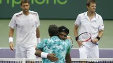 Leander Paes of India hugs Radek Stepanek of the Czech Republic in celebration after defeating Max Mirnyi of Belarus (L) and Daniel Nestor of Canada in their men's doubles match at the Sony Ericsson Open tennis tournament in Key Biscayne, Florida March 31, 2012. REUTERS/Andrew Innerarity (Andrew Innerarity/Reuters)