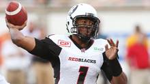 The Ottawa Redblacks' Henry Burris throws against the Montreal Alouettes during the first half of their game in Montreal on June 15. A new survey suggests the CFL is growing in popularity among Americans under 35. (Christine Muschi/Reuters)