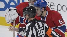 Montreal Canadiens' Max Pacioretty, right, shows his arm to a referee following an incident with Toronto Maple Leafs' Mikhail Grabovski as Canadiens' goaltender Carey Price looks on during third period NHL hockey action in Montreal, Saturday, February 9, 2013. Grabovski has been accused of biting Pacioretty's arm. (Graham Hughes/The Canadian Press)