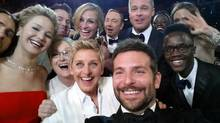 "This image released by Ellen DeGeneres shows actors front row from left, Jared Leto, Jennifer Lawrence, Meryl Streep, Ellen DeGeneres, Bradley Cooper, Peter Nyong'o Jr., and, second row, from left, Channing Tatum, Julia Roberts, Kevin Spacey, Brad Pitt, Lupita Nyong'o and Angelina Jolie as they pose for a ""selfie"" portrait on a cellphone during the Oscars at the Dolby Theatre on Sunday, March 2, 2014, in Los Angeles. (Bradley Cooper/AP)"