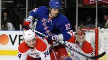 New York Rangers' Brian Boyle checks Washington Capitals' John Carlson (Bill Kostroun/Bill Kostroun/AP)