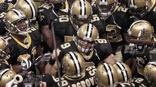 New Orleans Saints quarterback Drew Brees (9) talks with his team before the NFL football divisional playoff game between the Arizona Cardinals and New Orleans Saints in New Orleans, Saturday, Jan. 16, 2010. (Dave Martin/Associated Press)