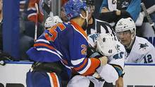 Edmonton Oilers defensemen Darnell Nurse fights San Jose Sharks defensemen Roman Polak during the third period at Rexall Place. (Perry Nelson/USA Today Sports)