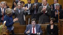 "Ottawa-Vanier MP Mauril Belanger, who lives with ALS (also known as Lou Gherig's disease) uses a tablet with text-to-speech program to defend his proposed changes to neutralize gender in the lyrics to ""O Canada"" in the House of Commons on Parliament Hill in Ottawa on Friday, May 6, 2016. (Adrian Wyld/THE CANADIAN PRESS)"