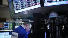 Traders work on the floor of the New York Stock Exchange on Feb. 21. (Spencer Platt/Getty Images)