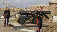Members of the 78th Highlanders prepare to fire the noon gun on Citadel Hill in Halifax on Monday April 10, 2006. Parks Canada's crumbling forts, historical houses and other heritage structures are in much poorer shape than the agency estimates. (Andrew Vaughan/THE CANADIAN PRESS)