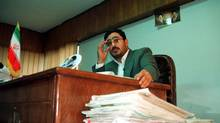 Tehran prosecutor Saeed Mortazavi adjusts his glasses in his office in Tehran, in this Nov. 1999, file photo. (HASAN SARBAKHSHIAN/AP)