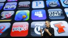 Apple Inc. Chief Executive Steve Jobs speaks in front of a display showing icons of various apps during the iPhone OS4 special event at Apple headquarters in Cupertino, California in this April 8, 2010 file photo. (ROBERT GALBRAITH/REUTERS)