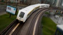 A SkyTrain commuter train travels into downtown Vancouver, B.C., on Wednesday April 11, 2012. (DARRYL DYCK/The Globe and Mail)