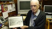 Thomas Goodyear, with a photograph of the ill-fated Merchant Navy ship, the Nova Scotia. (Ashley Colombe/Downhome Photo)