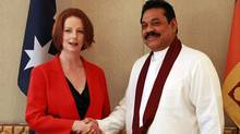 Australian Prime Minister Julia Gillard shakes hands with Sri Lanka's President Mahinda Rajapaksa during a bilateral summit ahead of the Commonwealth Heads of Government meeting in Perth on Oct. 26, 2011. (Daniel Munoz/Reuters)
