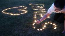 Candles are lighted on the town common during a vigil for James Foley in his hometown of Rochester, N.H. (Jim Cole/Associated Press)