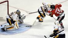 Nashville Predators goalie Pekka Rinne makes a save against Chicago Blackhawks center Artem Anisimov during the third period in Game 1 of a first-round NHL hockey playoff series in Chicago, on April 13, 2017. (David Banks/AP)