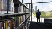 Floor-to-ceiling windows in the Fort York Library let visitors observe the ever changing cityscape of downtown Toronto. (Fred Lum/The Globe and Mail)