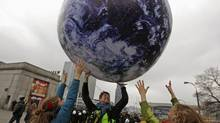 Environmental activists play with a giant globe on the streets in a rally demanding more action to battle climate change during the 19th conference of the United Nations Framework Convention on Climate Change (COP19) in Warsaw November 16, 2013. (KACPER PEMPEL/REUTERS)