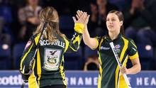 Northern Ontario third Kendra Lilly, right, high-fives Krista McCarville as they take on Canada during the Scotties Tournament of Hearts in St. Catharines, Ont., on Thursday, Feb. 23, 2017. (Sean Kilpatrick/THE CANADIAN PRESS)