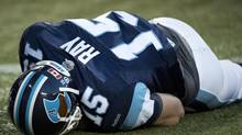 Toronto Argonauts quarterback Ricky Ray lays on the field injured while playing against the Calgary Stampeders during first half CFL football action in Toronto, on Friday, August 23, 2013. Ray left the game. (NATHAN DENETTE/THE CANADIAN PRESS)