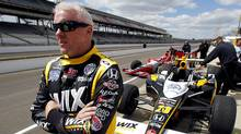 Paul Tracy, of Canada, looks down the pit lane during practice at the Indianapolis Motor Speedway in Indianapolis, Monday, May 16, 2011. (Darron Cummings/AP Photo/Darron Cummings)