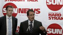 Pierre Karl Peladeau, right, president and CEO of Quebecor Inc., and Kory Teneycke, vice president of development of Quebecor Media, announce the companies' investment in the creation of a new English specialty channel called Sun TV News in Toronto on June 15, 2010. (Reuters/Mike Cassese/Mike Cassese/Reuters)
