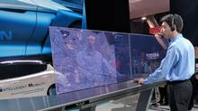 A Nissan representative demonstrates the company's autonomous car capabilities at the CES show in Las Vegas last week. The auto maker is co-developing its Seamless Autonomous Mobility (SAM) system with NASA. (Peter Nowak/The Globe and Mail)