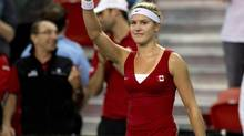 Eugenie Bouchard, of Canada, celebrates her win over Kristina Kucova, of Slovakia, during the second match at the Fed Cup tennis tournament Saturday, April 19, 2014 at Laval University in Quebec City. (Jacques Boissinot/THE CANADIAN PRESS)
