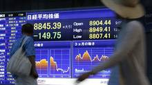 Concerns over the value of the yen and pushed the Nikkei average to a 16-month low on Wednesday. (Shizuo Kambayashi/Shizuo Kambayash/Associated Press)