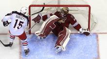 In this April 3, 2012 file photo, Phoenix Coyotes goalie Mike Smith makes a save on a shot by Columbus Blue Jackets' Derek Dorsett (15) during an NHL game, in Glendale, Ariz. (Ross D. Franklin/Associated Press)