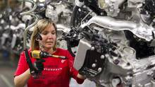 Engine Specialist Jennifer Souch assembles a Camaro engine at the GM factory in Oshawa, Ont., in 2011. (Frank Gunn/The Canadian Press)