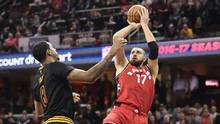 Toronto Raptors center Jonas Valanciunas shoots over Cleveland Cavaliers forward Channing Frye during the first quarter at Quicken Loans Arena in Cleveland, on April 12, 2017. (Ken Blaze/USA Today Sports)