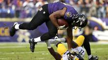 Running back Kenneth Dixon #30 of the Baltimore Ravens carries the ball against strong safety Robert Golden #21 of the Pittsburgh Steelers in the second quarter at M&T Bank Stadium on November 6, 2016 in Baltimore, Maryland. (Patrick Smith/Getty Images)
