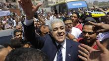 Presidential hopeful Hamdeen Sabahi greets his supporters after Friday prayers in Baltim city, 212 kilometers North of Cairo, Egypt, Friday, May 16, 2014. With only two people - former army chief Abdel-Fattah el-Sissi and leftist politician Hamdeen Sabahi - vying for the country's top post, the Egyptian election commission set the first round of voting for May 26 and 27, with results expected by June 5 (Hamdeen Sabahi/AP)