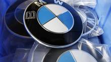 BMW luxury car logos are pictured in a spare-parts store at a BMW garage in Niderwangen near Bern, May 24, 2012. (Pascal Lauener/REUTERS)