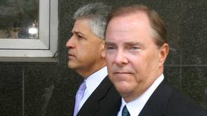 Former Enron Chief Executive Officer Jeff Skilling, right, and his attorney Daniel Petrocelli arrive at the federal court in Houston for sentencing on Oct. 23, 2006.
