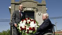 Former prime minister Jean Chretien and former German chancellor Helmut Schmidt lay a wreath at the gravesite of former prime minister Pierre Elliott Trudeau in Saint-Remi, Que., on June 1, 2011. (Paul Chiasson/The Canadian Press)