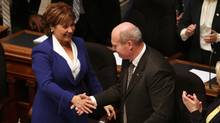 Finance Minister Michael de Jong shakes hands with Premier Christy Clark after delivering a balanced budget speech for a fourth year in a row at Legislative Assembly, in Victoria on Feb. 16. (CHAD HIPOLITO/THE CANADIAN PRESS)