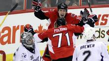 Ottawa Senators' Zack Smith (15) celebrates with teammate Nick Foligno's (71) goal to tie the game 2-2 as Tampa Bay Lightning's Eric Brewer and goaltender Dwayne Roloson(35) look on during third period NHL hockey action in Ottawa Saturday March 19, 2011. The Sens won 3-2 in overtime. THE CANADIAN PRESS/Fred Chartrand (FRED CHARTRAND)